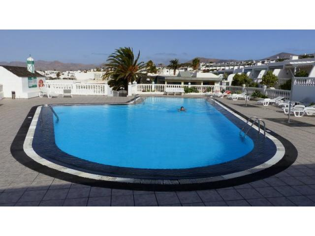 Private swimming pool - Lovely Seaview Apartment , Puerto del Carmen, Lanzarote