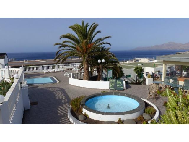 Fountain and swimming pool for the kids - Lovely Seaview Apartment , Puerto del Carmen, Lanzarote