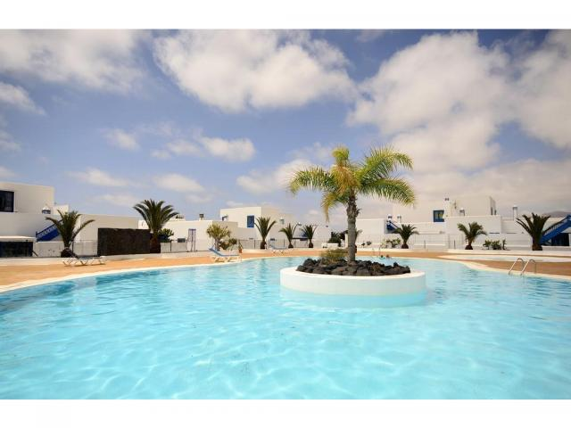 Pristine apartment in the exclusive resort of Puerto Calero, Lanzarote, 2 bedroom apartment close to exclusive marina with spacious communal Pool