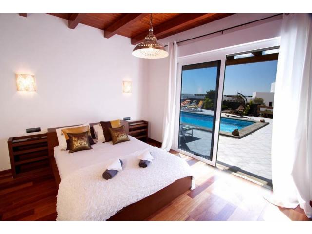 The villa has 4 large bedrooms all with air con & family en suit bathrooms. A large fully equipped modern kitchen , living room with English tv channels & free WiFi.  Outside you with find a large cli