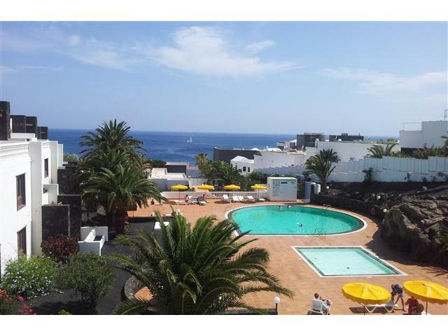 Beautifully maintained and landscaped apartment complex situated opposite the main Playa Grande beach in Puerto del Carmen, offering high quality two bedroom apartments on a gated community