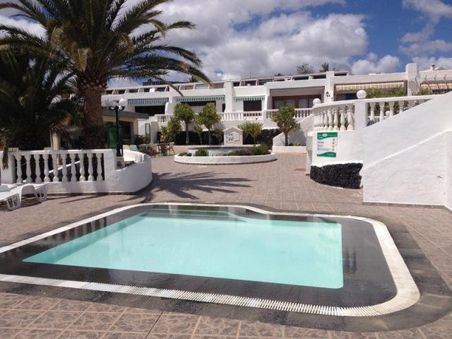 Swimming pool for the kids - Lovely Seaview Apartment , Puerto del Carmen, Lanzarote