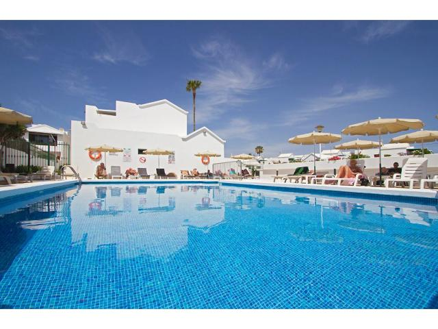 Our beautiful heated swimming pool - 2 Bed - Diamond Club Maritima, Puerto del Carmen, Lanzarote