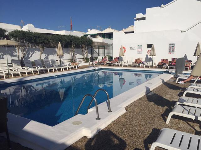 Pool side sunbathing area - 2 Bed - Diamond Club Maritima, Puerto del Carmen, Lanzarote