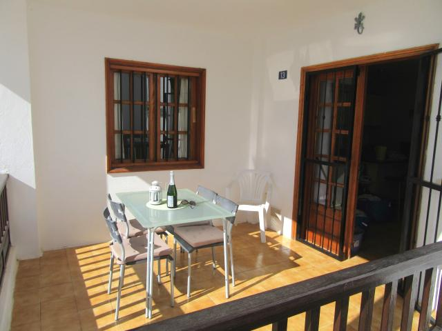 Covered terrace is great for dining - Old Town apartment, Puerto del Carmen, Lanzarote